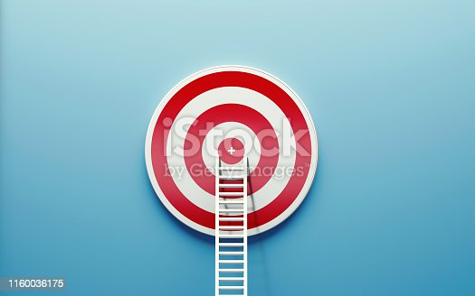 1127097479istockphoto White Ladder Leaning on A Target on Blue Wall 1160036175