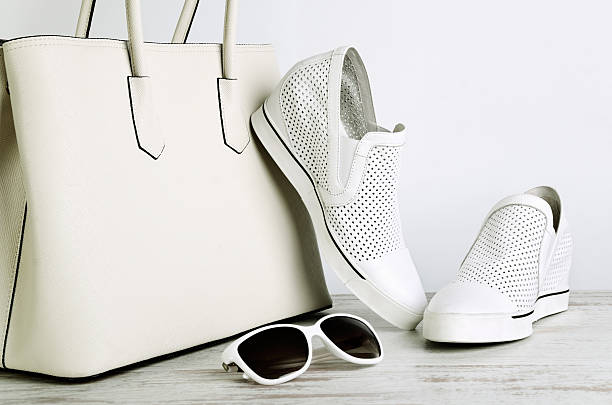 White ladies handbag, shoes and sun glasses on  light background - Photo