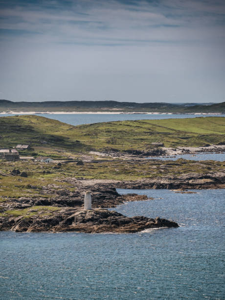 White lady Mystery day time maritime marker lighthouse  at clifden bay, Ireland stock photo