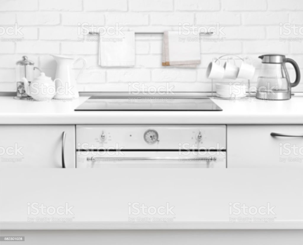 White laminated table on defocused rustic kitchen bench interior background stock photo