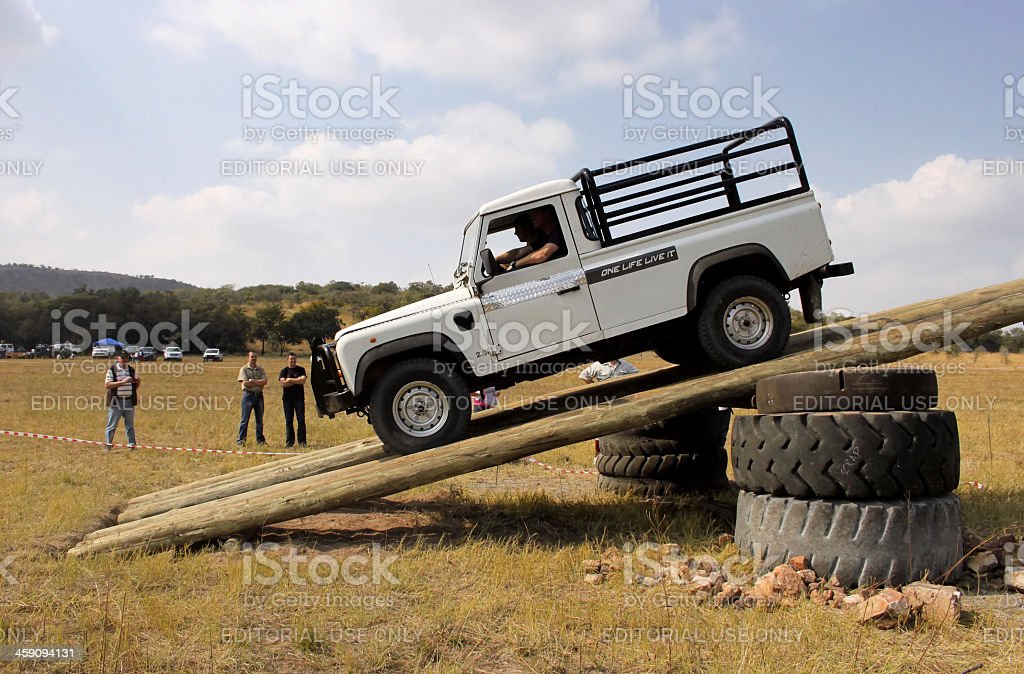 White Land Rover Defender 110 HC on 4x4 Course stock photo