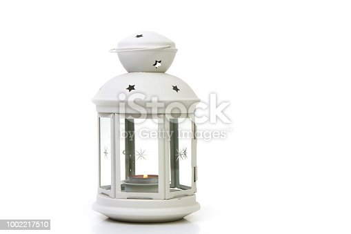 white lighthouse with a burning candle inside on a white background
