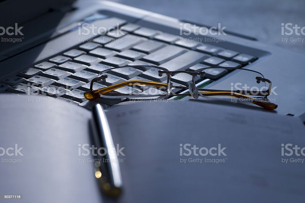 white laptop and glasses royalty-free stock photo
