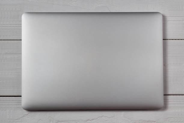 white laptop on wooden table - closed stock photos and pictures