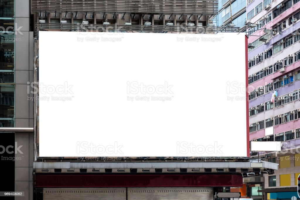 White large billboard for rent on building stock photo