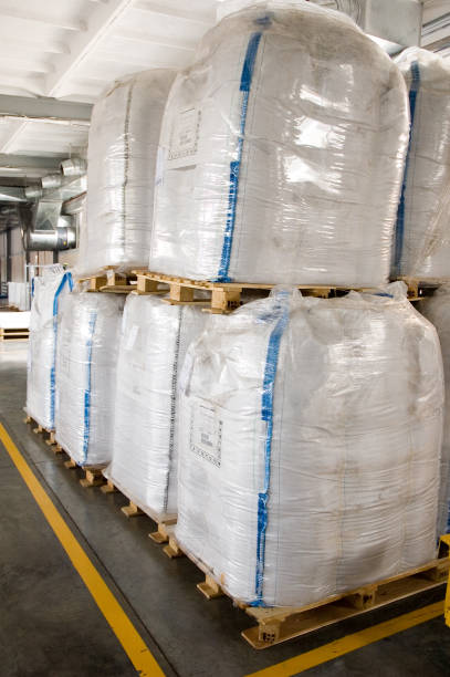 White large containers for bulk material on pallets stock photo