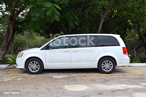 Uxmal, Mexico - 30 December, 2018: White MPV vehicle Dodge Grand Caravan parked on the street. This model is popular family car in North America.