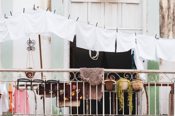 White Laundry Hanging on Balcony Clothes Line stock photo
