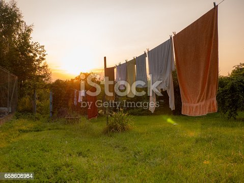istock White laundry is drying outside 658608984