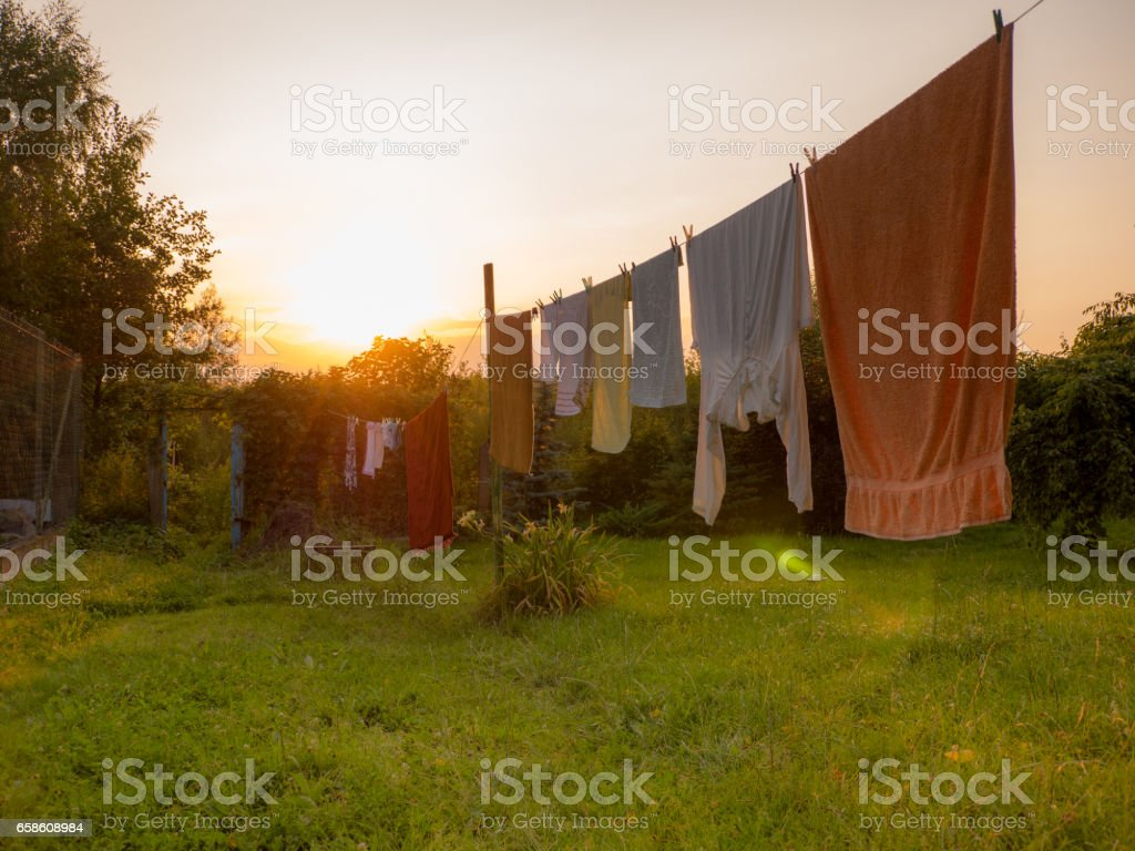 White laundry is drying outside stock photo