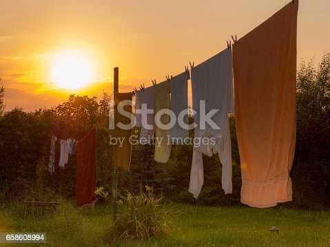 istock White laundry is drying outside 658608994