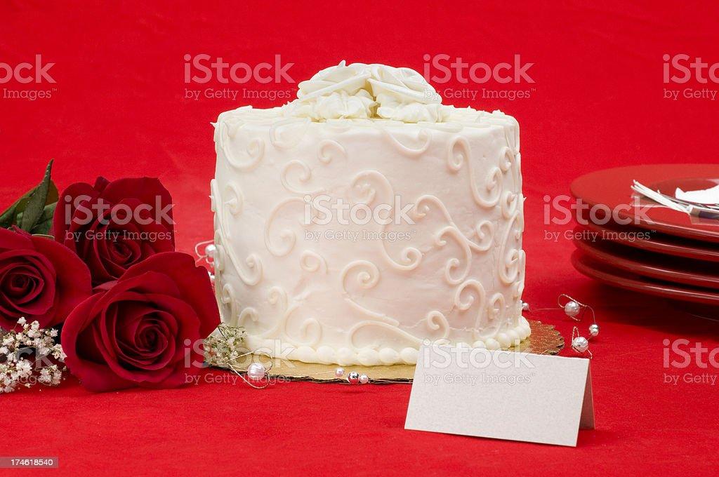 White layered wedding cake with roses stock photo