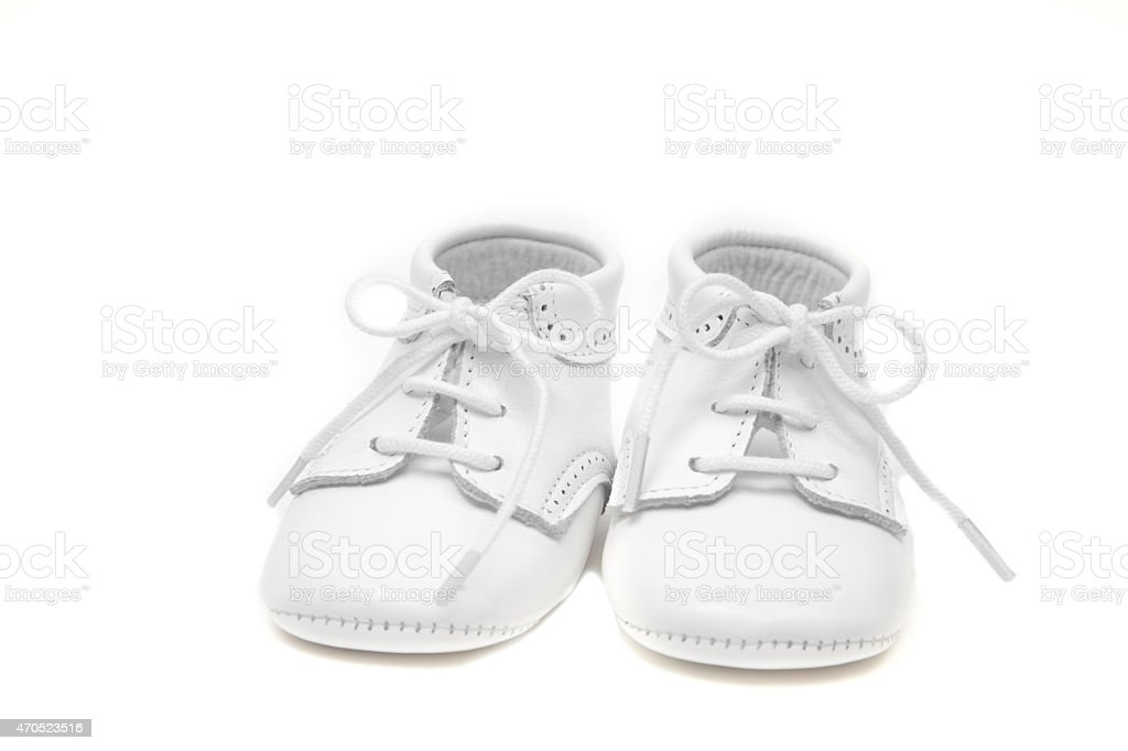 White leather baby shoes isolated on white stock photo