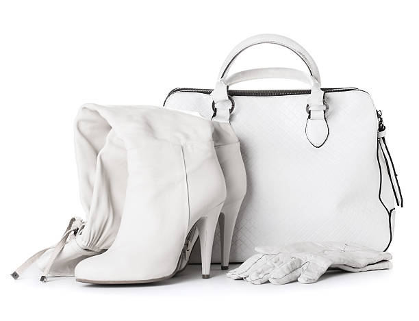 White leather bag, shoes and glowes stock photo