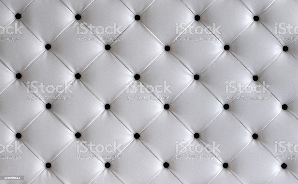White leather button headboard background stock photo