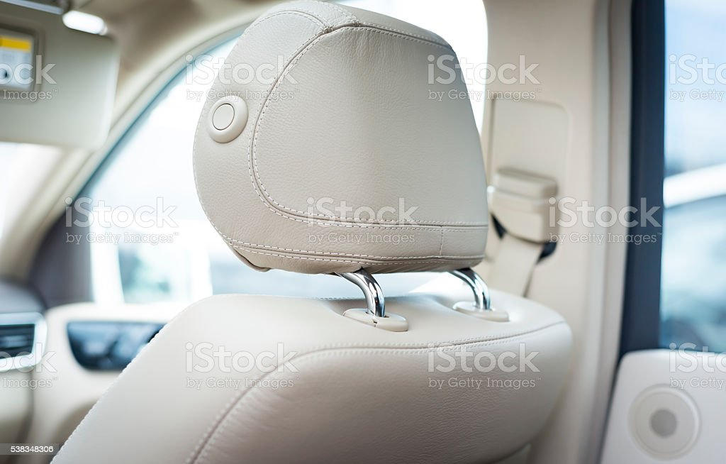 White leather car seats  detail with focus on stitch stock photo