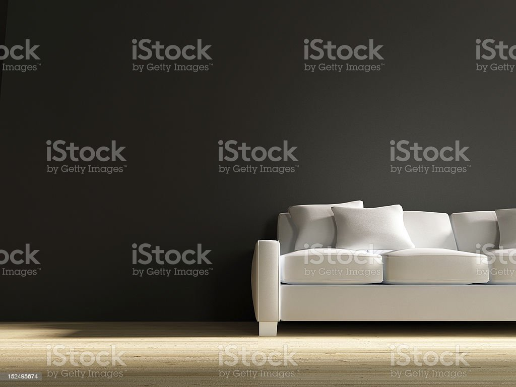 White leather Couch to face a blank black wall stock photo