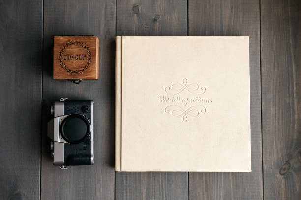 White leather wedding album, wooden box with inscription Wedding day and vintage photo camera stock photo