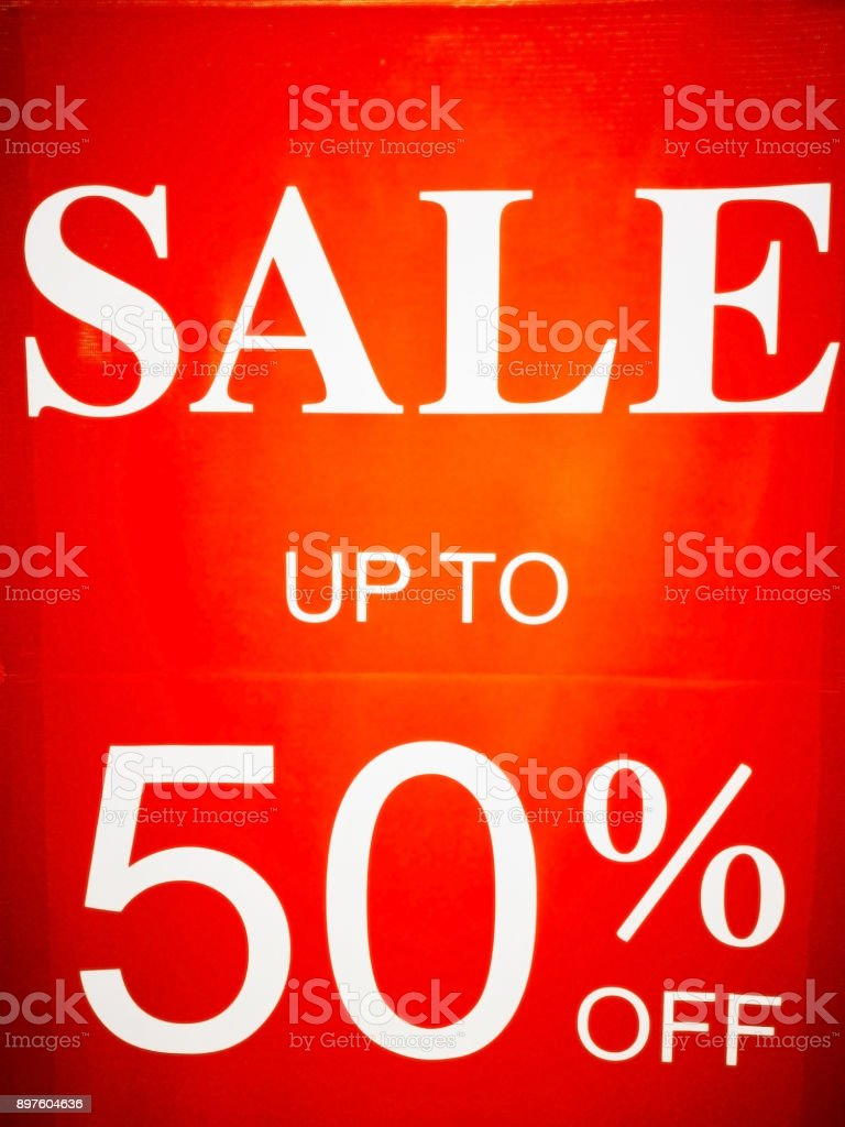 White letters isolated on a red background, announces fifty percent discount. stock photo