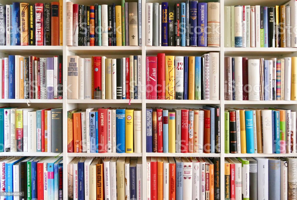 White Library Book Shelves Packed With Colorful Books Stock Photo ...