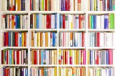 White library book shelves packed with colorful books