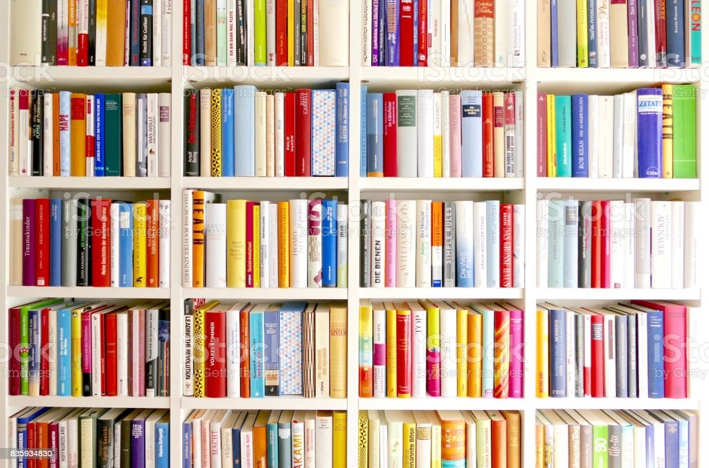 White library book shelves packed with colorful books - fotografia de stock