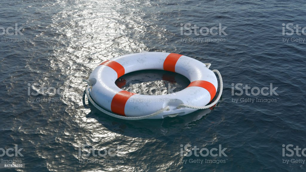 White lifebuoy in sea. stock photo