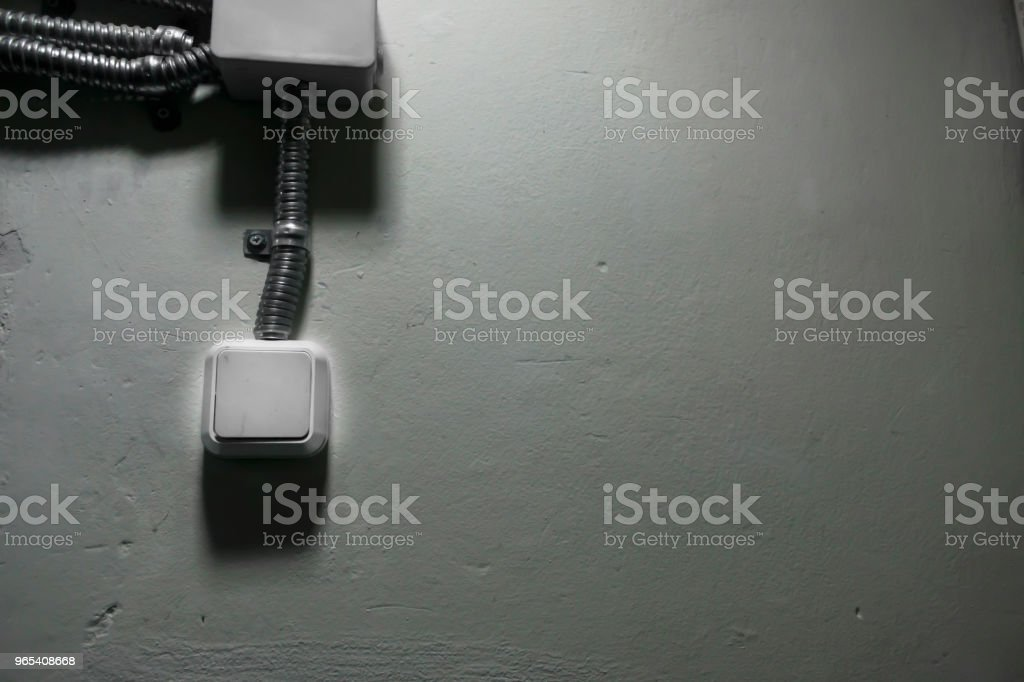 white light switch on a white wall royalty-free stock photo
