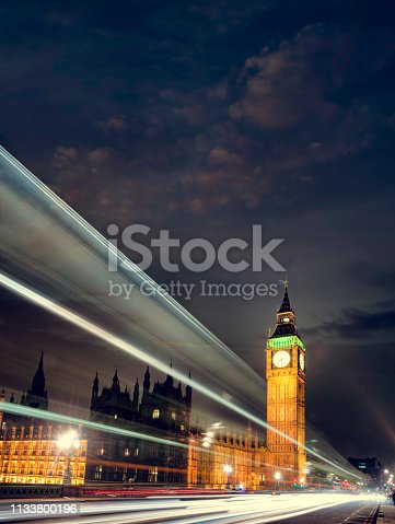 White Light Trails Passing Big Ben At Night In London, England
