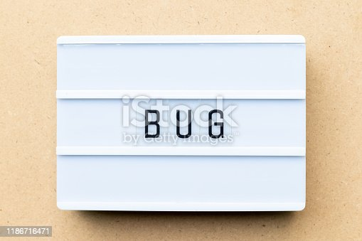 istock White lightbox with word bug on wood background 1186716471