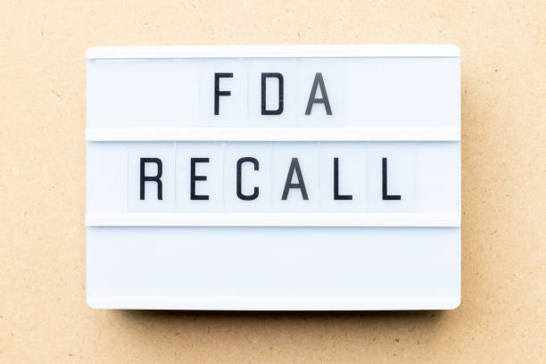 white lightbox with word fda recall on wood background - fda stock photos and pictures