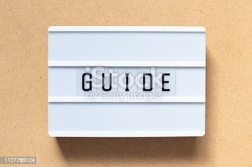 815359666 istock photo White lightbox with word guide on wood background 1127785124