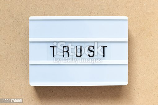 939533958 istock photo White lightbox with word trust on wood background 1224175695