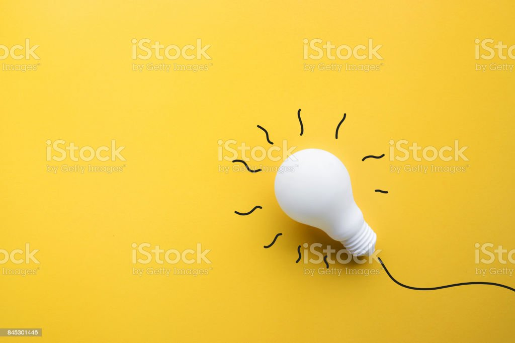 White lightbulb on pastel color background.Ideas creativity stock photo