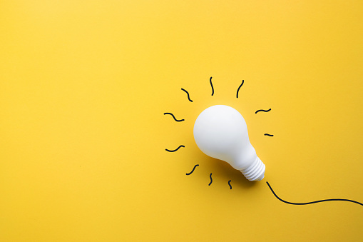 White Lightbulb On Pastel Color Backgroundideas Creativity Stock Photo - Download Image Now