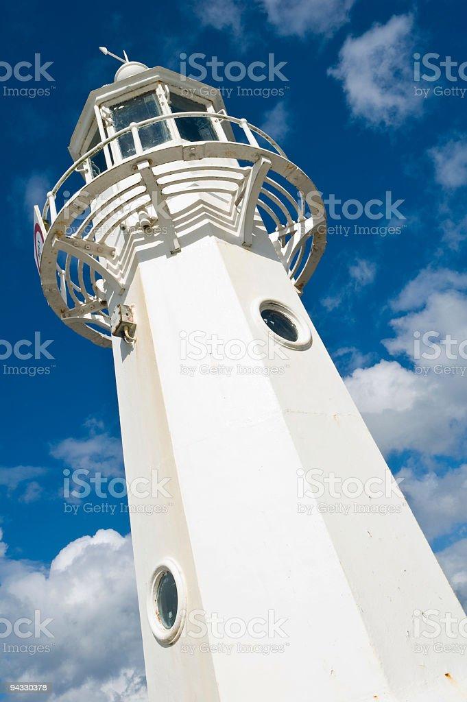 White lighthouse, blue skies royalty-free stock photo