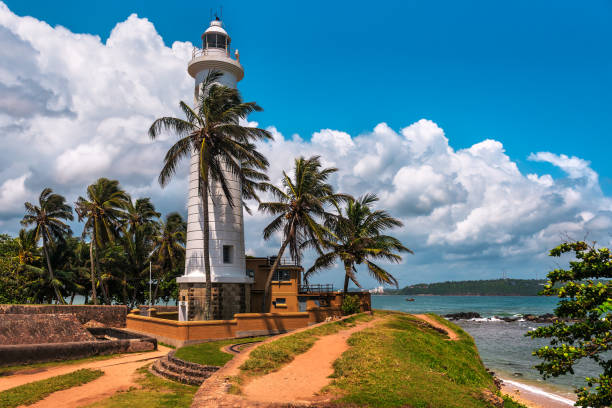 white lighthouse in fort Galle stock photo