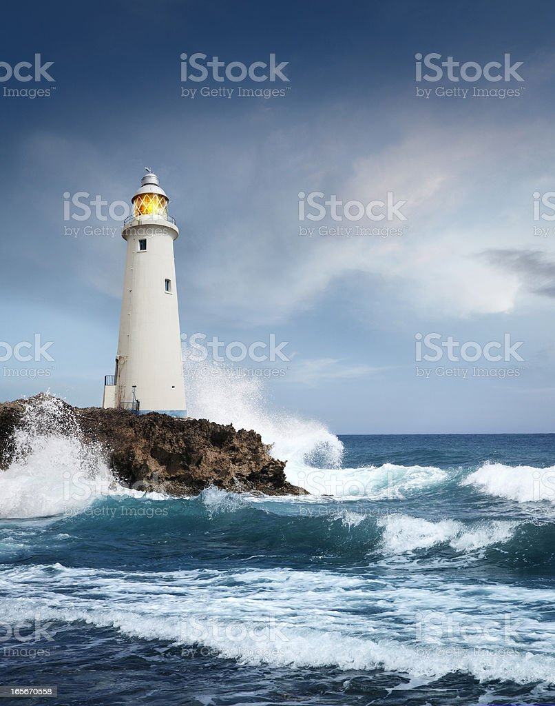 White lighthouse on the cliff royalty-free stock photo