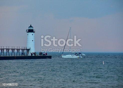 177362898istockphoto White lighthouse on the coast of Lake Michigan 1014582272
