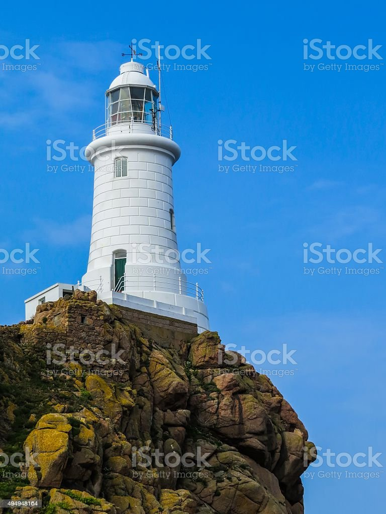 White Lighthouse on the rock. Jersey, Channel Islands stock photo