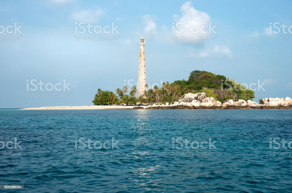White lighthouse standing on an island in Belitung. stock photo