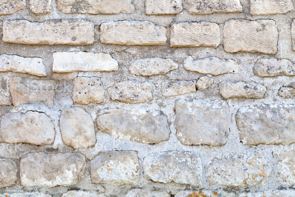 White limestone wall Full frame close-up on a white limestone wall. Abstract Stock Photo