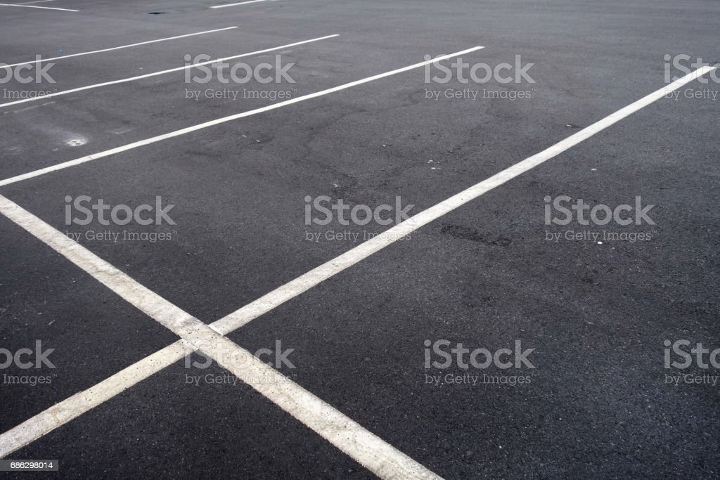 White line in empty parking lot. stock photo