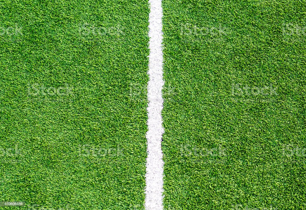 White line on soccer field grass stock photo
