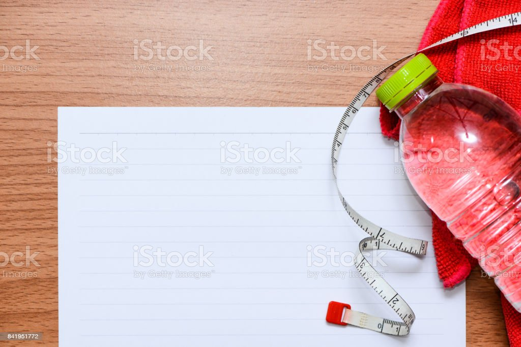 White line paper with sport equipments  to plan for your health, top view stock photo