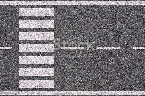white lines and crosswalk inserted on asphalt background