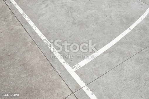 istock white lines on concrete floor - vintage sport background 944733420