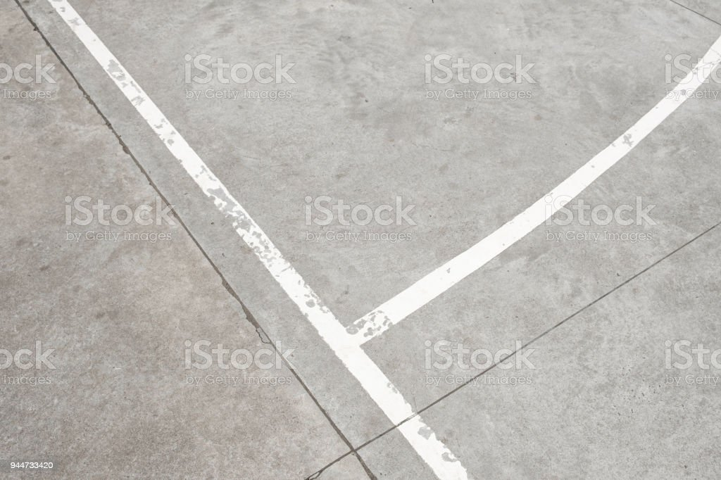 white lines on concrete floor - vintage sport background stock photo