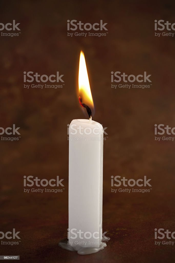 White lit candle royalty-free stock photo
