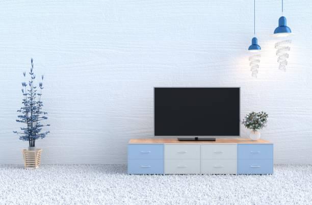 weiße wohnzimmer dekor mit weißen holz wand, teppich, rose weiß glas vase, fernsehen, lampe, ast baum. weihnachten tag und neues jahr. 3d render. - teppich hellblau stock-fotos und bilder